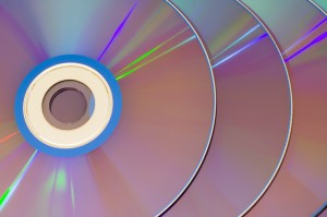 Closeup of a row of CDs overlapping.