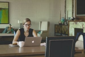 woman working at home computer