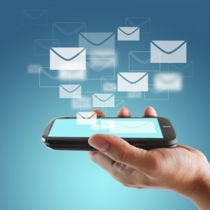 Mobile phone with emails floating out of phone