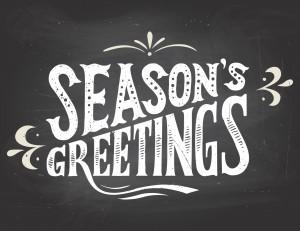 Season's greetings on chalkboard background